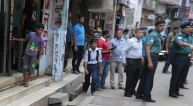 Police stand guard following the death of a student activist in Dhaka, Bangladesh (AP)