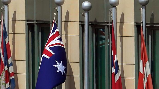 The Australian flag flies outside a compound that houses the Australian Embassy in Beirut, Lebanon (AP)