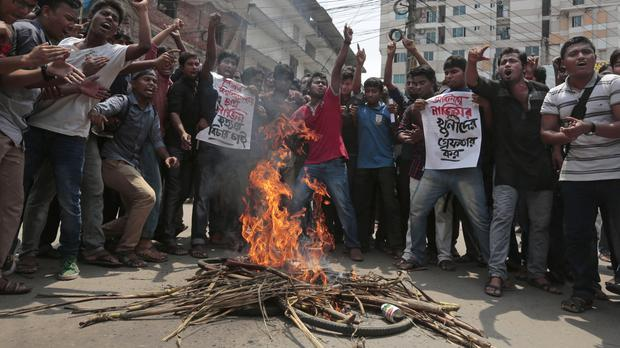 Bangladeshi students protest after blogger Nazimuddin Samad was hacked to death in Dhaka (AP)