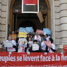 Anti-fraud activists chant slogans while blocking entrances at Societe Generale's Paris headquarters as part of a protest accusing the French bank of ties to the so-called Panama Papers (AP)
