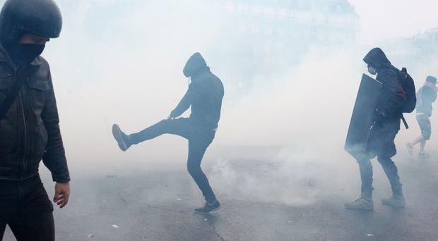 Demonstrators during clashes with police as part of a protest against the proposed changes to France's working week and lay-off practices, in Paris (AP)