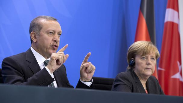 German Chancellor Angela Merkel and Turkey's Prime Minister Recep Tayyip Erdogan (AP)