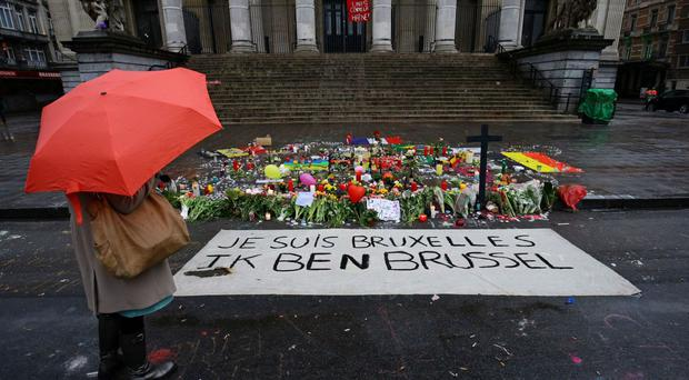 Floral tributes and candles left in the Place de la Bourse, Brussels, following the terrorist attacks in the city