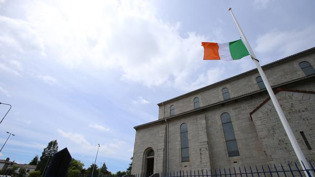 A flag flies at half mast at Our Lady of Perpetual Succour church in Foxrock, Dublin, to honour the victims of the Berkeley balcony collapse