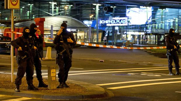 Hooded security forces at Schiphol Airport after military police arrested a man (AP)