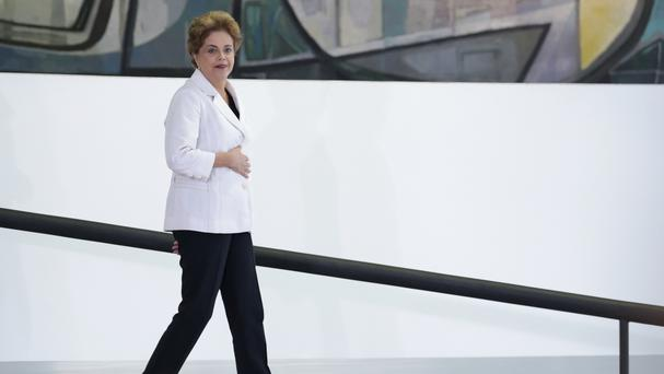 Dilma Rousseff arrives for a ceremony with teachers and students at Planalto presidential palace in Brasilia (AP)