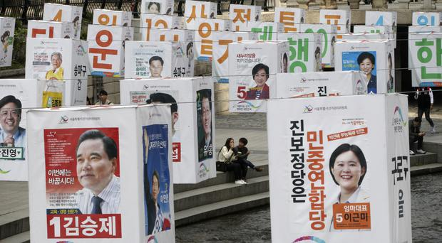 Election posters of candidates for Seoul's constituencies in parliamentary election (AP)