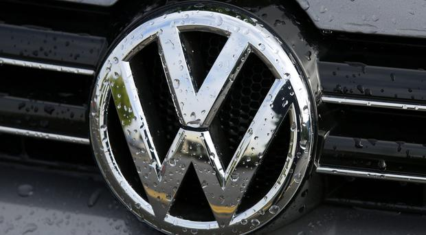 Volkswagen says it will cut its managerial bonus scheme