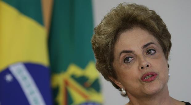 Dilma Rousseff speaks during a meeting at the Planalto Presidential Palace, in Brasilia (AP)