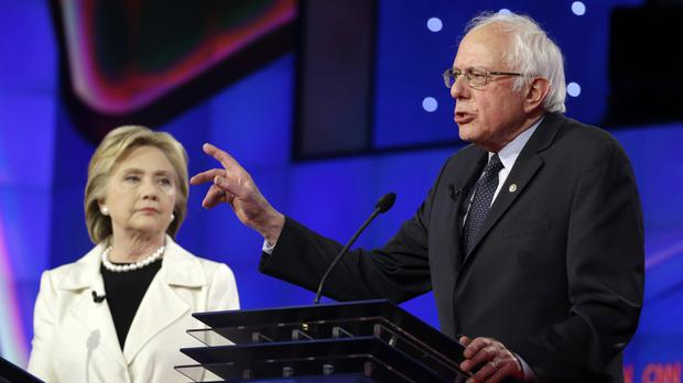 Democratic presidential candidates Bernie Sanders and Hillary Clinton during the televised debate in Brooklyn (AP)