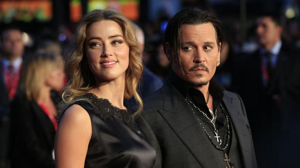 Amber Heard and Johnny Depp attending the premiere of Black Mass in London's Leicester Square