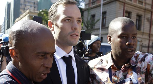Oscar Pistorius leaves the High Court in Pretoria, South Africa (AP)