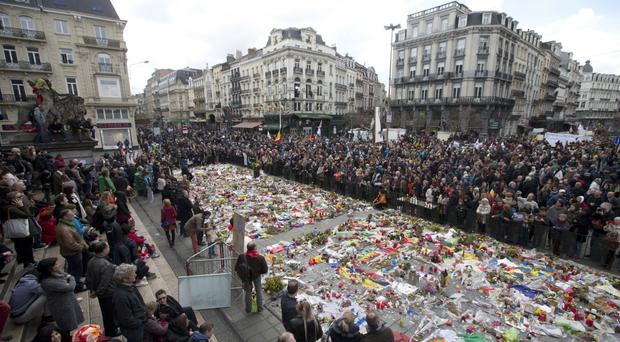 Marchers gather at a memorial to victims of the Brussels attacks during a march against hate in Brussels (AP)