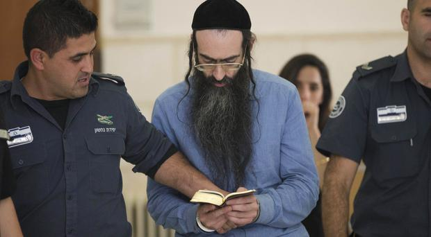 Yishai Schlissel, who fatally stabbed a girl and wounded others at Jerusalem's gay pride parade last year, in court (AP)
