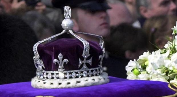 The Queen Mother's priceless crown, containing the Koh-i-noor diamond, was placed on her coffin