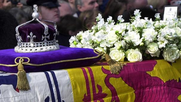 The Queen Mother's priceless crown, containing the famous Koh-i-noor diamond set in the Maltese Cross, rests on her coffin in Westminster Hall