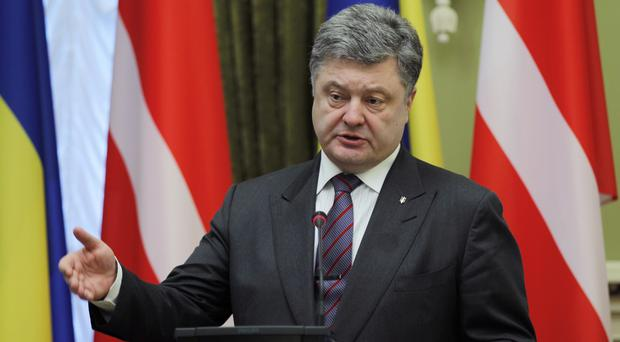 Ukrainian president Petro Poroshenko signed the bill (AP)
