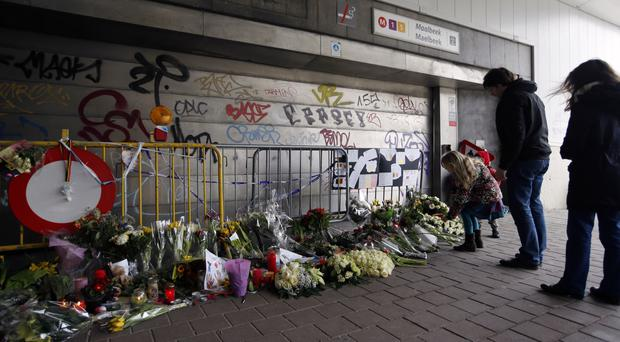 Floral tributes outside Maelbeek metro station in Brussels (AP)
