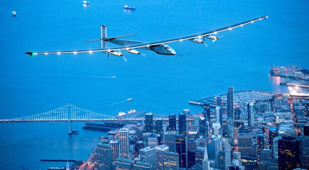 Solar Impulse 2 flies over San Francisco after a three-day journey across the Pacific Ocean (AP)