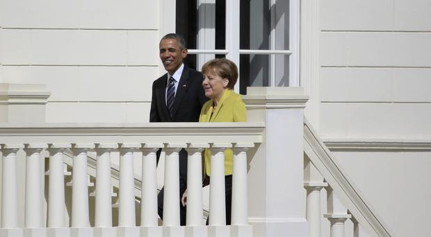 Angela Merkel shows Barack Obama around the Herrenhausen Palace