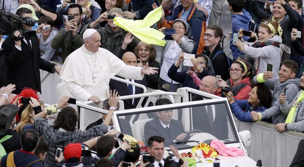 Pope Francis greeting pilgrims in St Peter's Square
