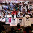 Parents of some of the 43 missing students during a press conference (AP)