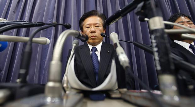 Mitsubishi Motors President Tetsuro Aikawa listens to a reporter's question during a press conference in Tokyo (AP)