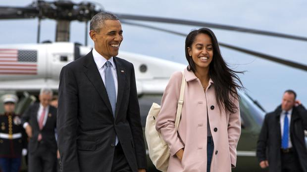 US president Barack Obama with his elder daughter Malia (AP)