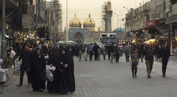 The Imam Mousa al-Kadhim shrine commemorates the anniversary of the Imam's death in Baghdad eight years ago (AP)