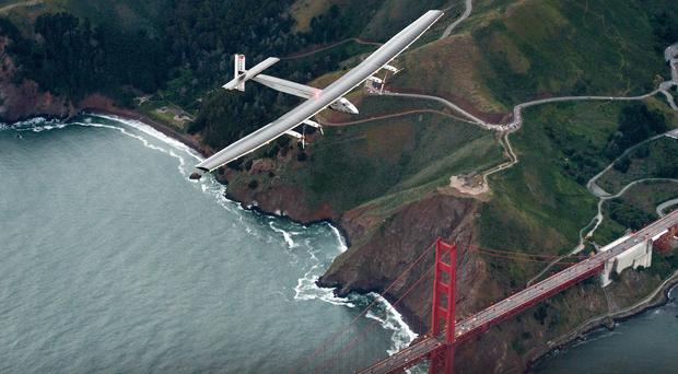 Solar Impulse 2 flies over the Golden Gate Bridge in San Francisco (AP)