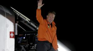 Pilot Andre Borschberg exits the cockpit of the Swiss-made Solar Impulse 2 (AP)