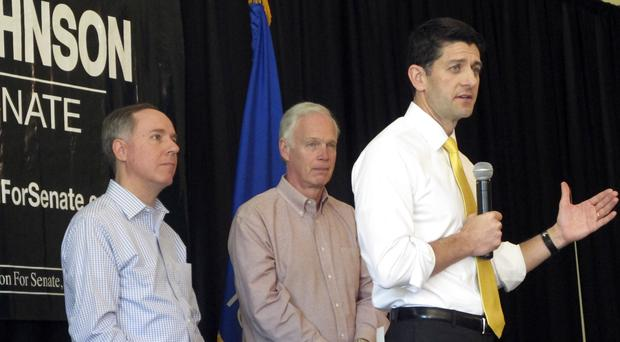 Paul Ryan, right, addresses a rally in Burlington, Wisconsin (AP)