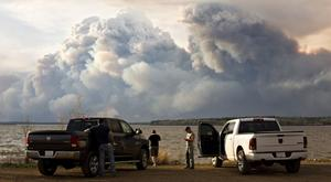 Evacuees watch the wildfire near Fort McMurray, Alberta (AP)