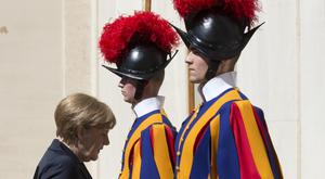 German chancellor Angela Merkel arrives at the St Damaso courtyard at the Vatican ahead of her private meeting with Pope Francis (AP)