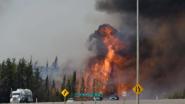 A wildfire breaks out along highway 63 about 10 miles south of Fort McMurray (Jonathan Hayward/Canadian Press/AP)