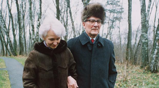Margot Honecker walking with husband Erich in a park in Moscow in 1991 (AP)