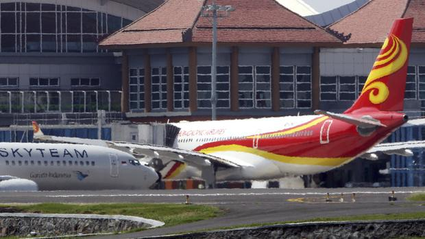 A Hong Kong Airlines Airbus A330-200 sits on the tarmac at Ngurah Rai airport in Bali, Indonesia, after 17 people were injured by turbulence (AP Photo/Firdia Lisnawati)