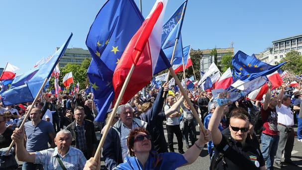 Opponents of Poland's government march in protest (AP)