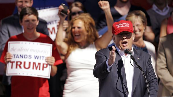 Donald Trump elicits cheers from supporters at a rally in Lynden, Washington (AP)