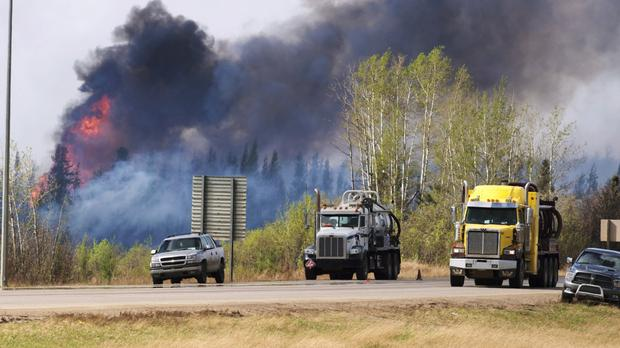 Flames flare up from hotspots along the highway to Fort McMurray (The Canadian Press/AP)