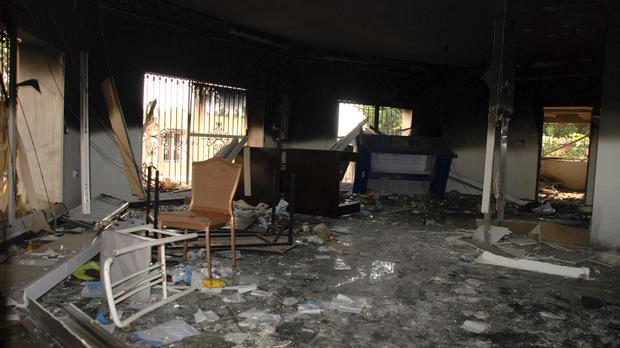 Glass, debris and overturned furniture are strewn inside a room in the gutted US consulate in Benghazi (AP/Ibrahim Alaguri)