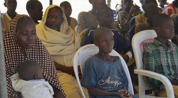 Woman and children detained by the Nigerian army at Giwa military barracks in Maiduguri (AP)