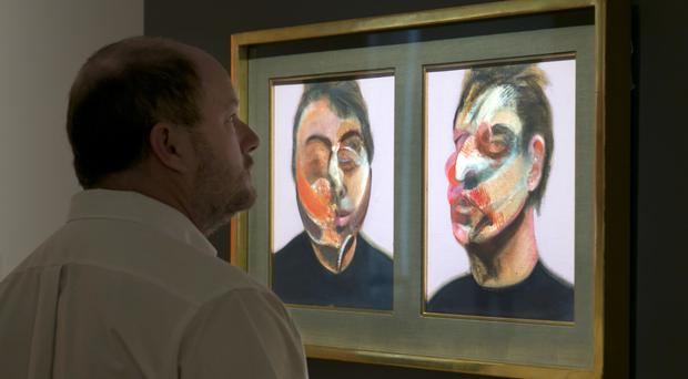 Francis Bacon's Two Studies for a Self-Portrait is viewed at Sotheby's in New York (AP)
