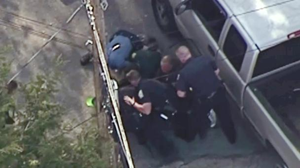 Still from a video showing police tackling Richard Simone in New Hampshire (WHDH/AP)