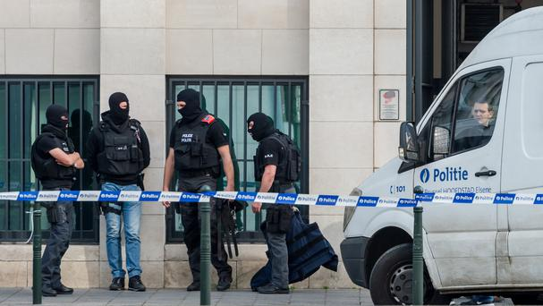 Police stand guard as terror suspect Mohamed Abrini's case is discussed in court at a justice building in Brussels (AP)