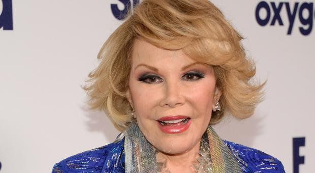 Joan Rivers' family have settled a medical malpractice lawsuit against Yorkville Endoscopy (AP)