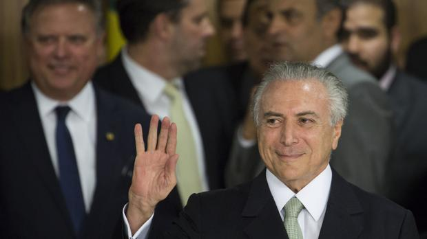 Brazil's acting President Michel Temer has said his priority will be reviving the country's economy. (AP)