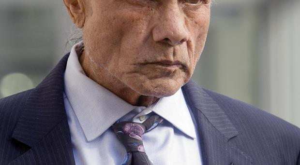 Former professional wrestler Jimmy Snuka leaves the Lehigh County Courthouse (AP)