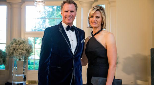 Will Ferrell and his wife Viveca Paulin arrive at the White House (AP)