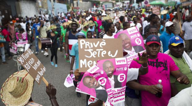 Protesters demand the resignation of interim president Jocelerme Privert in Port-au-Prince, Haiti (AP)